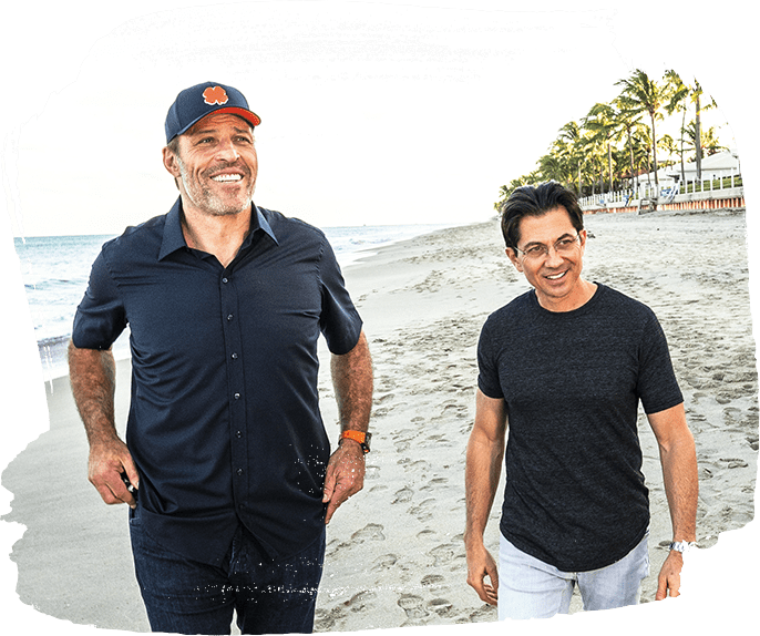 Tony Robbins and Dean Graziosi on a beach